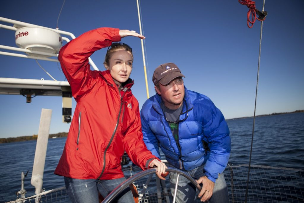Alexandra Cousteau and Geoff Green, captain of the Arctic Tern and Founder and Executive Director of Students On Ice Expeditions, sail in the Thousand Islands of Lake Ontario outside of Ganonoque, Ontario. Students On Ice Expeditions takes high school students from around the world on expeditions to the Arctic and Antarctica. © Blue Legacy/Oscar Durand