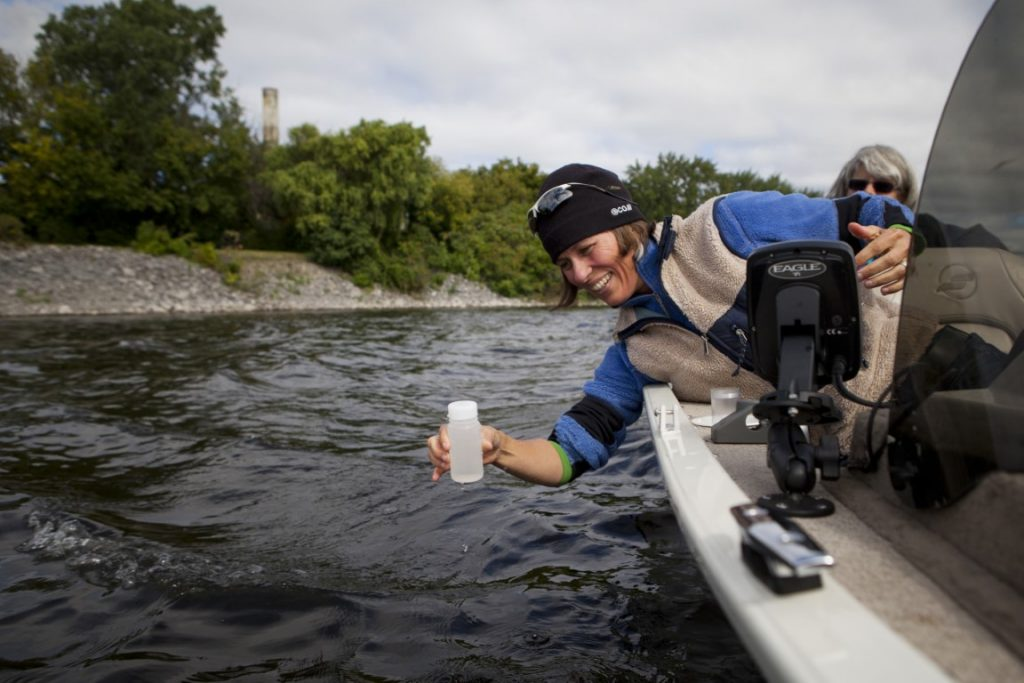 Meredith Brown, Ottawa Riverkeeper, tests the water on the river in Ottawa, Ontario, Canada.