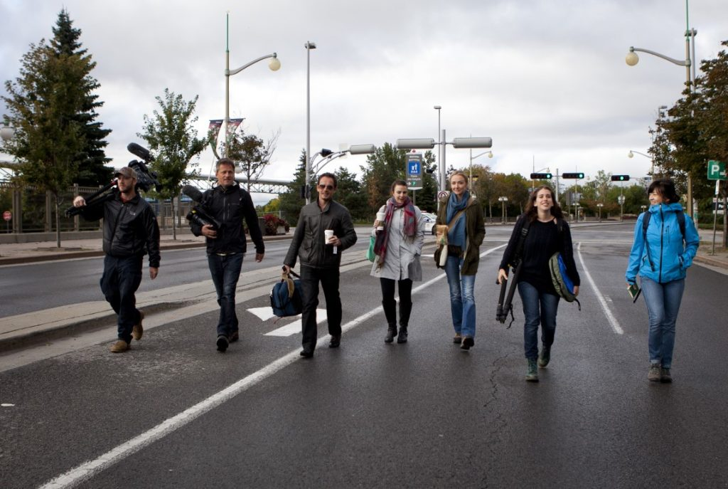 Expedition team, Parker Brown, Christoph Schwaiger, Rich Hallam, Amanda Pope, Alexandra Cousteau, Anne-Solne Bayan and Anne Casselman walk in downtown Ottawa with their filming gear in Ontario, Canada.