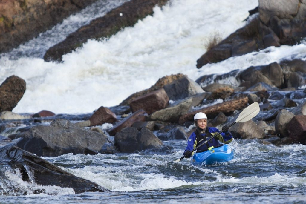 Alexandra Cousteau whitewater kayaking at the Potomac Gorge in Virginia © Blue Legacy/Oscar Durand